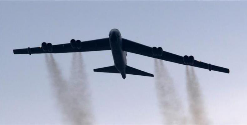 A B-52 bomber conducts a ceremonial fly-over above the Pentagon, May 28, 2017. (Photo by AFP)