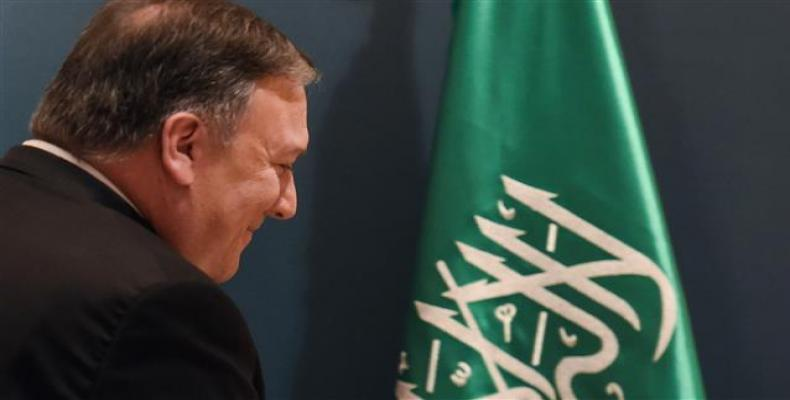 US Secretary of State Mike Pompeo leaves the press hall after giving a press briefing at the Royal airport in the Saudi capital Riyadh on April 29, 2018. (Photo