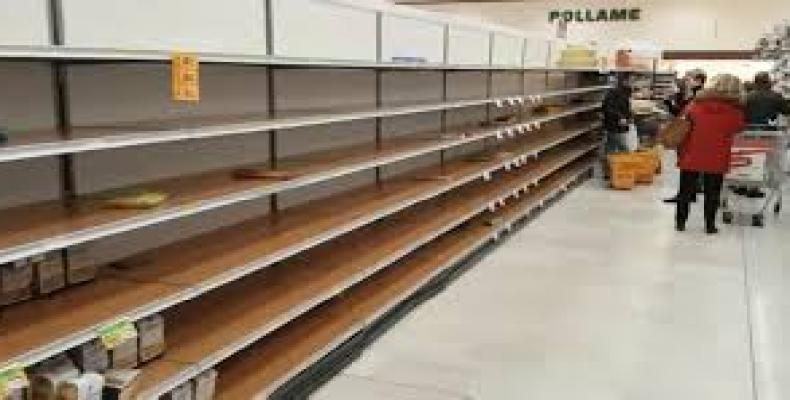 Empty shelves at store in Italy.