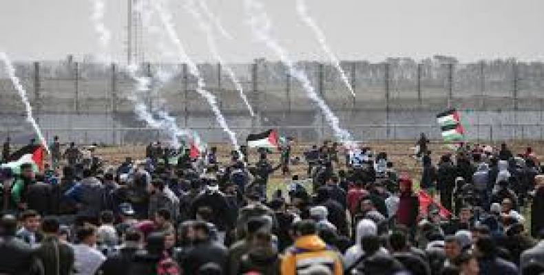 At least 4  killed by 'Israeli fire' as Palestinians rally on 1st anniversary of 'Great March of Return'. RT Photo