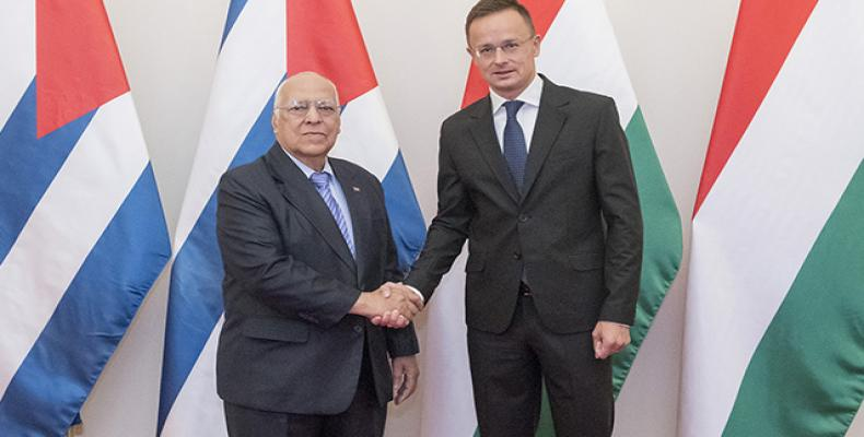 Cuban Vice President Ricardo cabrisas (left) and  Deputy Prime Minister and Minister of Finance Mihaly Varga,
