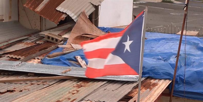 Puerto Rico marks anniversary of Hurricane Maria as Donald Trump denies death count.  Photo: AP