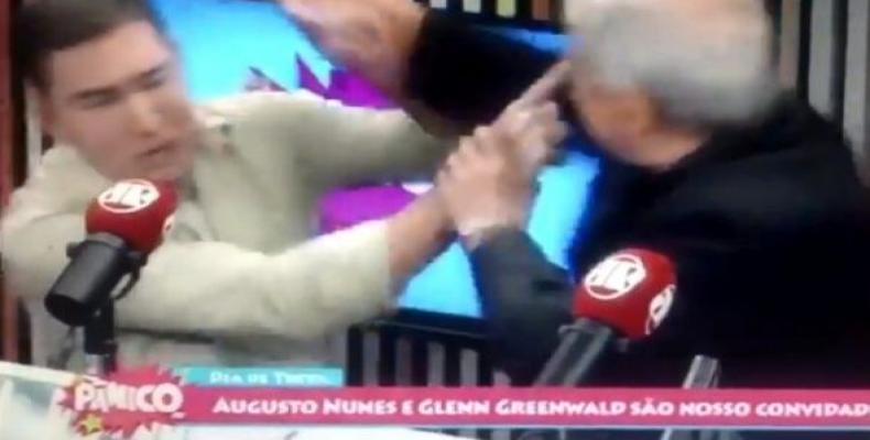 Augusto Nunes, a columnist and defender of Brazilian President Jair Bolsonaro, assaulted The Intercept's Glenn Greenwald during a live broadcast. (Photo: Twit