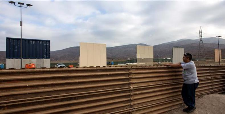 A man watches across the border from Tijuana, Mexico, to prototypes of US President Donald Trump's proposed wall on the border with Mexico, October 12, 2017. (P