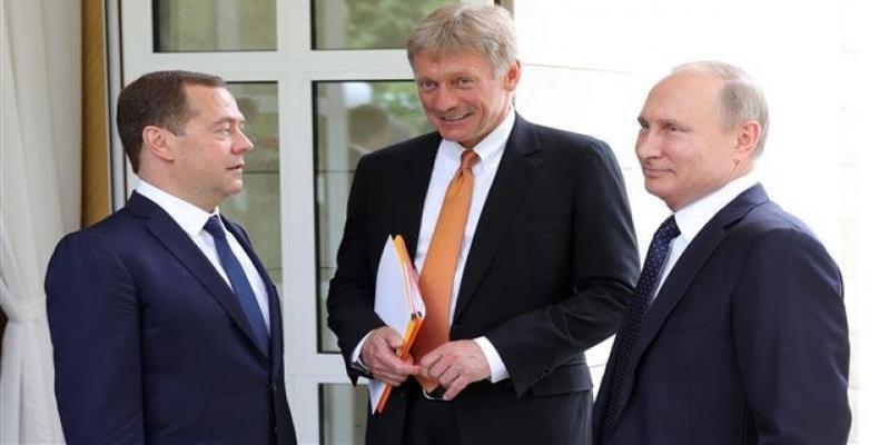 Russia's presidential spokesman Dmitry Peskov (C), President Vladimir Putin (R), and Prime Minister Dmitry Medvedev.  Photo: AFP