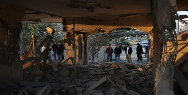 Palestinians check house after it was demolished by Israeli forces in the occupied West Bank city of Jenin on April 24, 2018.   Photo: AFP