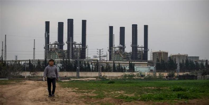 A Palestinian boy walks back from the Gaza Strip's sole electricity plant on February 15, 2018.  Photo by AFP