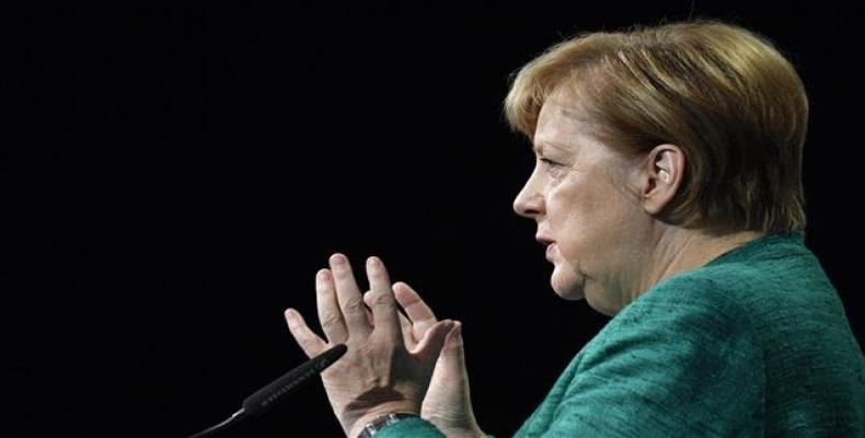 German Chancellor Angela Merkel addresses the audience during a conference organized by the Federation of German Industries (BDI) on September 25, 2018 in Berli