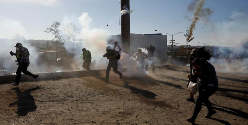 Migrant families tear gassed on U.S. border with Mexico.  Photo: Reuters