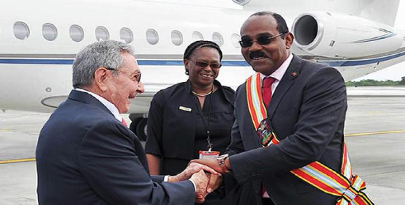 Upon his arrival in Saint Mary's, President Raul Castro is welcomed by Antigua and Barbuda Prime Minister Gaston Browne.