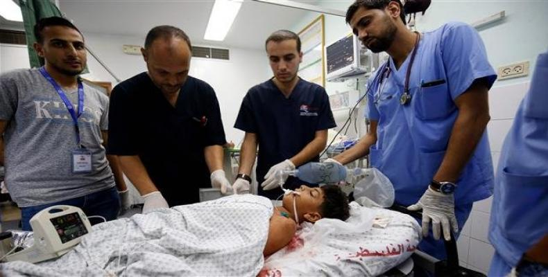 Palestinian minor Youssef Abu Zarifa, wounded during clashes along the border between the Gaza Strip and Israeli-occupied territories, receives treatment at a h