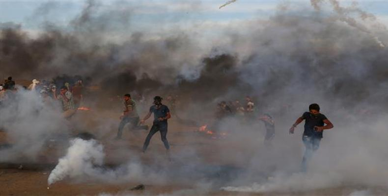 Clashes between Palestinians and Israeli forces across the fence, following a demonstration along the border between the Gaza Strip and the occupied territories