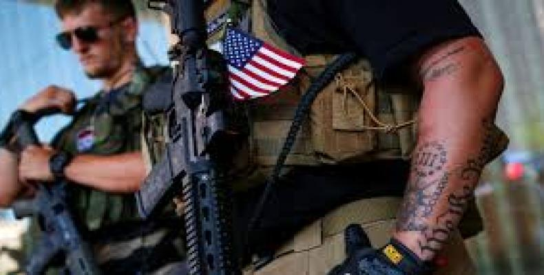 Armed militias on U.S. border with Mexico.   Photo: AFP