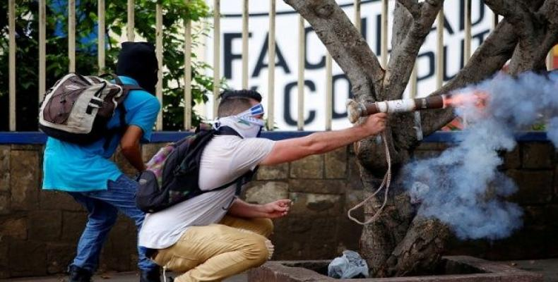 Nicaraguan protester fires homemade mortar at riot police.  Photo: Reuters