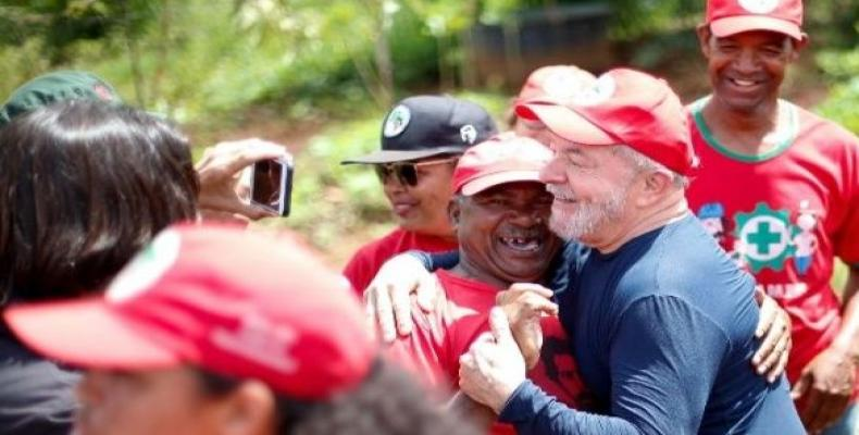 Former Brazilian President Luiz Inacio Lula da Silva is greeted by a member of the Rural Landless Movement.  Photo: Reuters