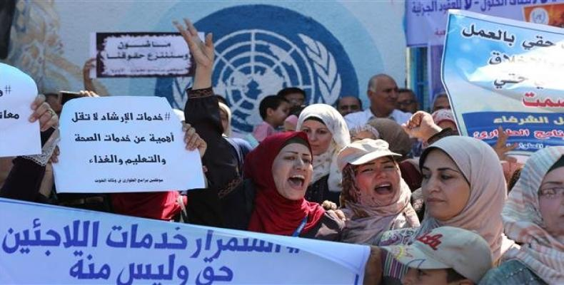 UN staff leaves Gaza over security concerns after job cuts.  Photo: AP