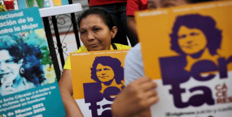 Women demonstrators outside the court presiding over the murder case of Indigenous land rights activist Berta Caceres, in Tegucigalpa, Honduras Nov. 29, 2018.
