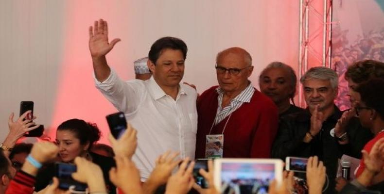 Fernando Haddad waves at a news conference during a runoff election in Sao Paulo, Brazil.   Photo: Reuters