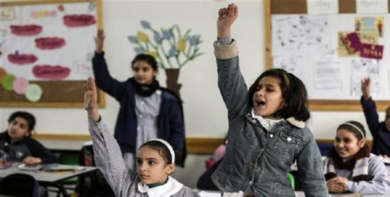 Palestinian schoolgirls attend a class at a school belonging to the United Nations Relief and Works Agency for Palestine Refugees (UNRWA) in Gaza City on Januar