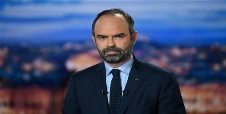 """French Prime Minister Edouard Philippe poses at the French TV channel TF1 studios in Boulogne-Billancourt, near Paris, on January 7, 2019, as he makes """"public o"""