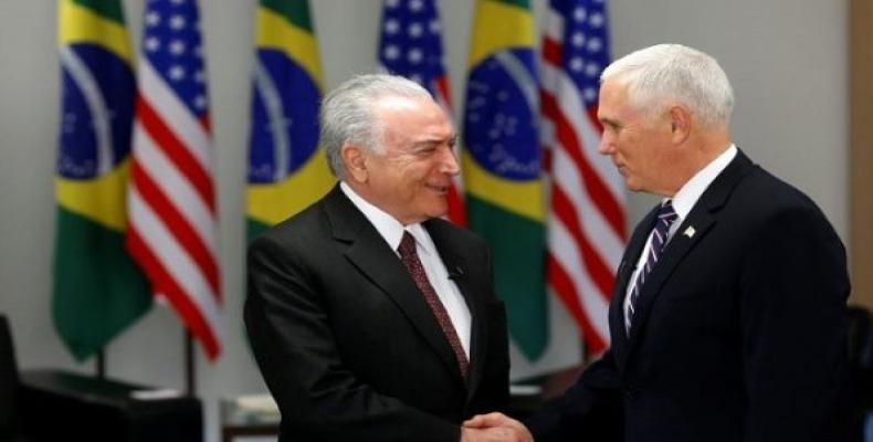 Brazil's un-elected president Michel Temer greets U.S. VP Mike Pence.   Photo: Reuters