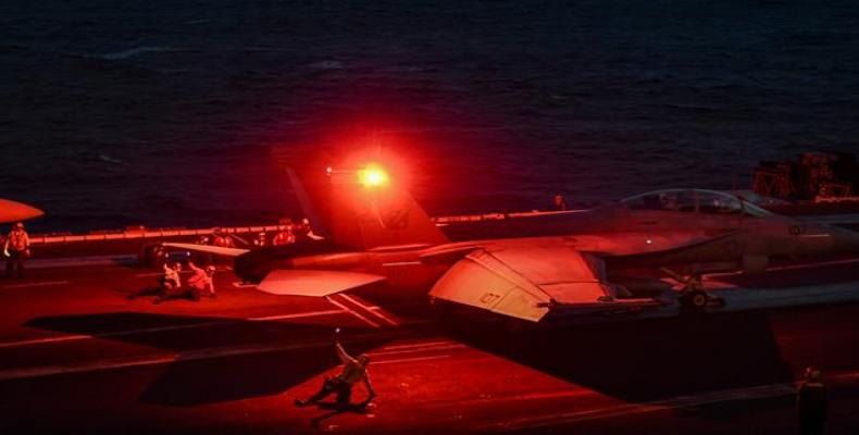 F-18 Hornet fighter jet waits to take off from the deck of the US navy aircraft carrier, the USS Harry S. Truman, in the eastern Mediterranean Sea on May 8, 201