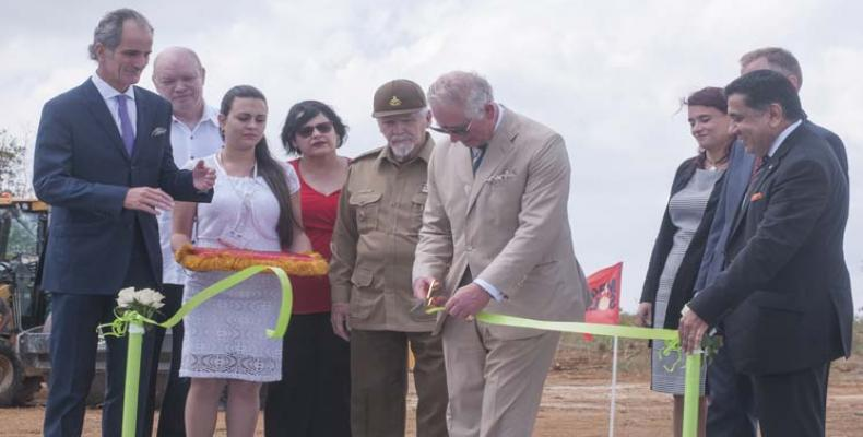 Prince Charles cuts the ribbon on a British renewable energy project in Mariel free-trade zone