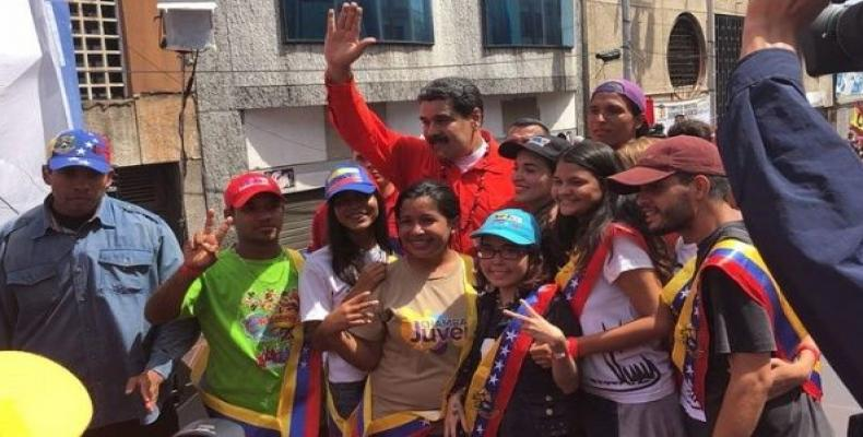 Venezuelan President Nicolas Maduro poses for photos with residents of Bolivar state after speaking to the press at the launch of his electoral campaign.  Photo