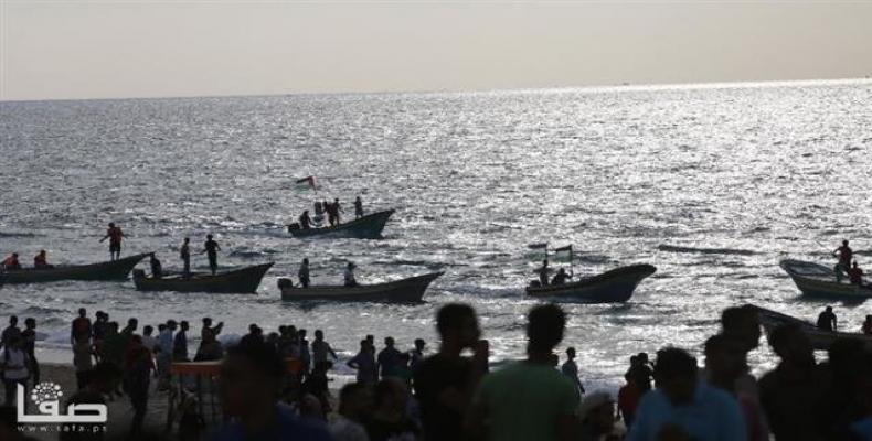 People in the northern part of the besieged Gaza Strip hold a naval rally in protest against the decade-long Israeli siege on the impoverished sliver, on Octobe