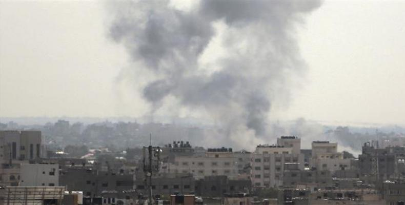 Smoke rises from the site of an Israeli airstrike on Gaza City on May 29, 2018.   Photo: AP