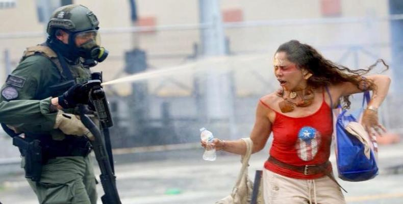 Puerto Rican police fire tear-gas at young protesters.  Photo: AP
