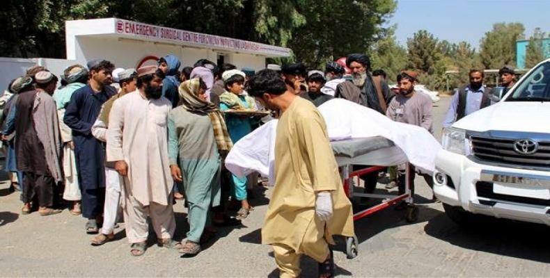 Afghan villagers carrying a dead body on a stretcher.  (Photo: AFP)