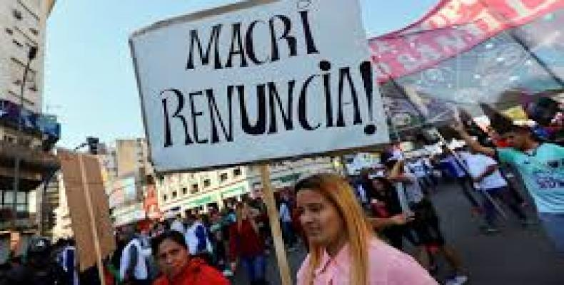 """Macri, resign!"" reads a sign in demonstration against the government's economic measures in Buenos Aires"