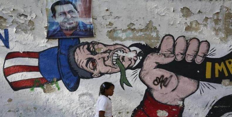 Mural in Caracas, showing Venezuela strangling U.S. imperialism.   Photo: AFP