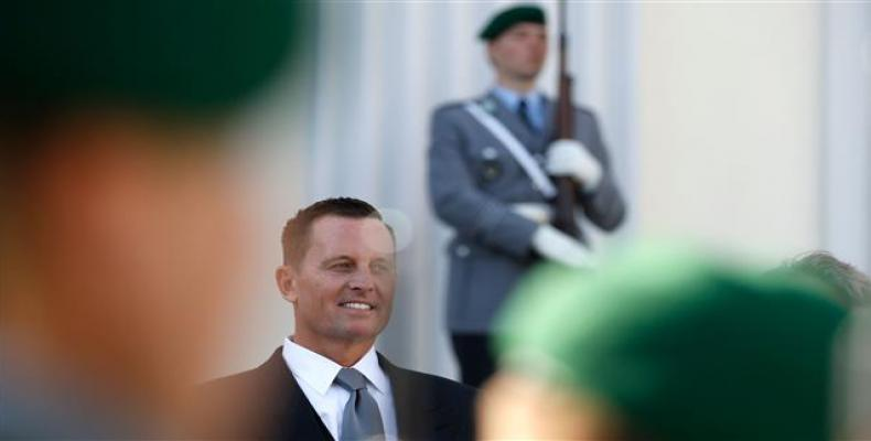 Newly accredited US Ambassador Richard Allen Grenell stands in front of a military honor guard during an accreditation ceremony for new Ambassadors in Berlin, G