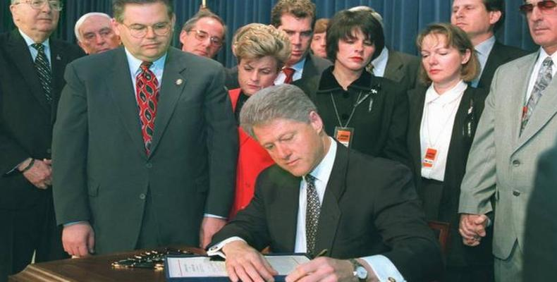 Moment former US President Bill Clinton signed int law the Helms Burton Act in March 1996. File Photo