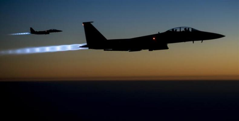 The file photo taken by the US Air Forces Central Command shows a pair of US Air Force F-15E warplanes flying over northern Iraq after conducting airstrikes in
