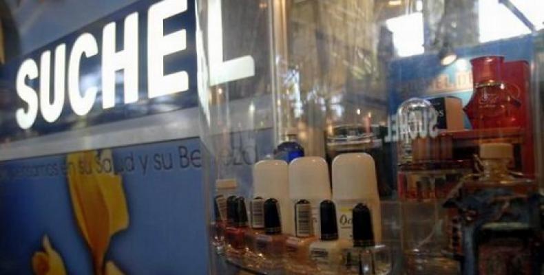 El nombre de la actualmente más importante productora de perfumes cubana se debe a los lirios, a los cuales se les llamaba Súchel o Súcheli, según el sabio Juan