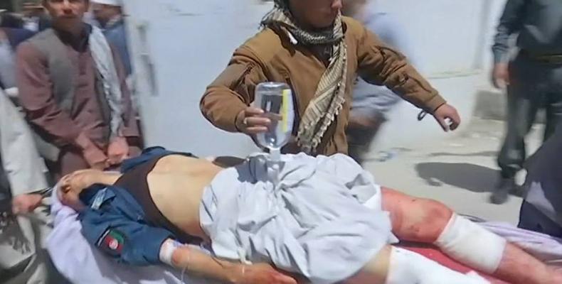 Afghan suicide bomb kills 57.  Photo: Reuters
