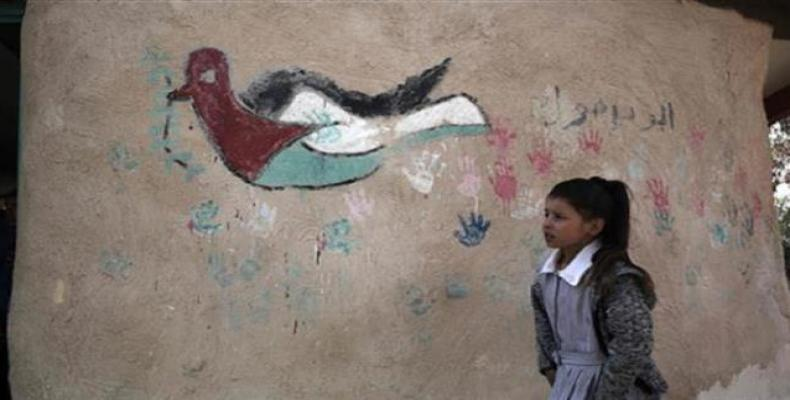 A Palestinian girl walks at her school in the village of Khan al-Ahmar in the Israeli-occupied West Bank on February 23, 2017.  Photo: AFP
