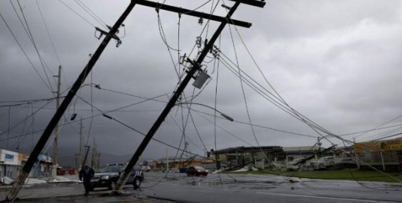 Since last September, dozens of the cities in Puerto Rico remain dark and abandoned without running water or electricity.  Photo: Reuters