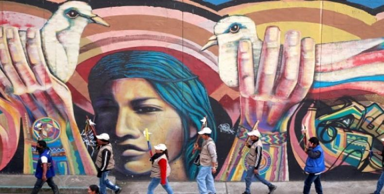 Mural in Bogota, showing need for peace.  Photo: AP
