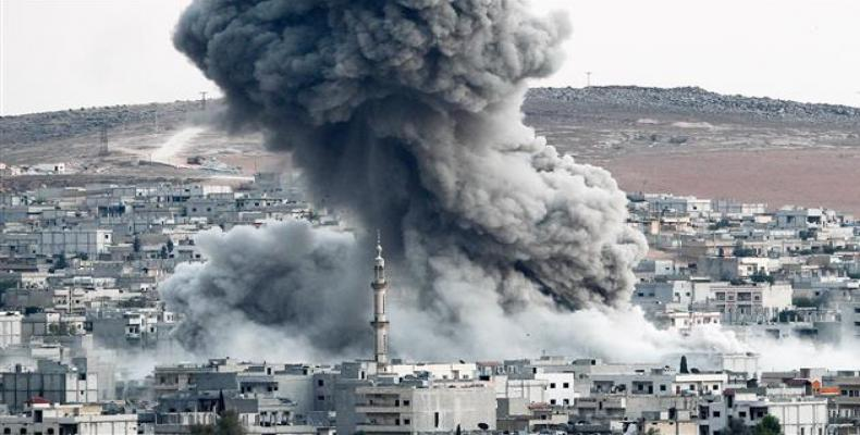 In this file photo, heavy smoke rises from Kobani, Syria, following an airstrike by the US-led coalition there.  Photo: Getty Images