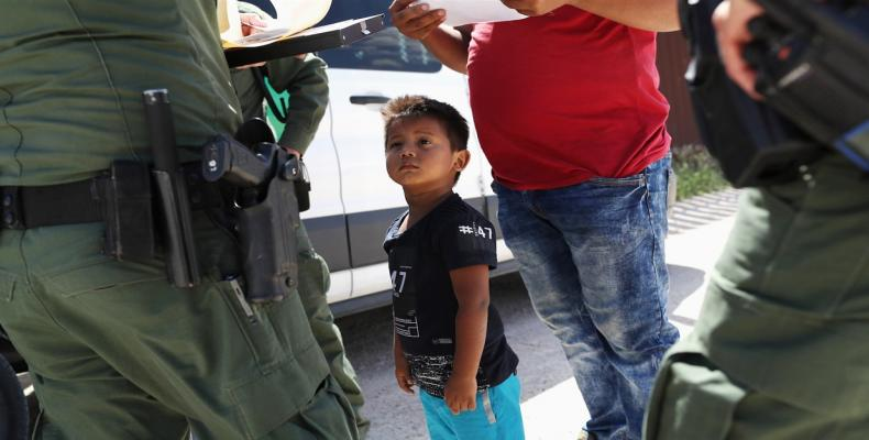 Migrant families about to be processed in Texas.  Photograph: Larry W. Smith/EPA