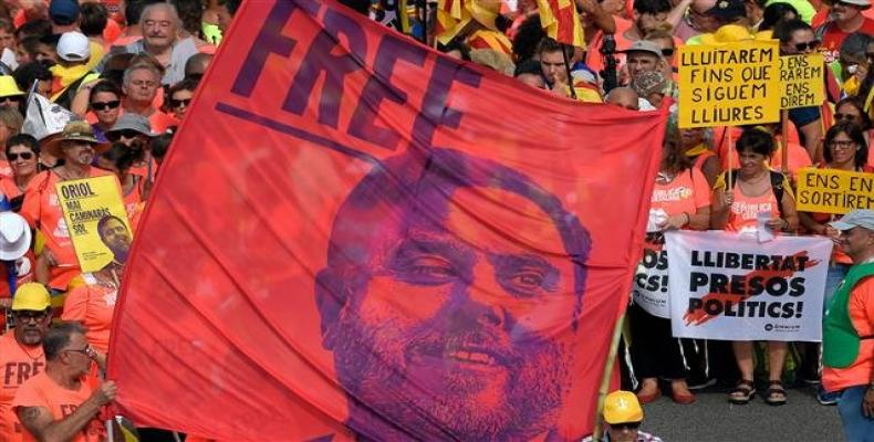 Demonstrators hold a banner demanding freedom of jailed Catalan leader Oriol Junqueras as they gather to take part in a pro-independence demonstration in Barcel