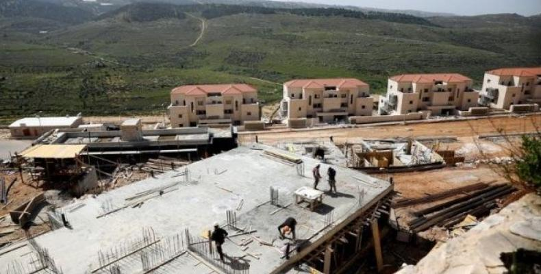 Workers at a construction site in the Israeli settlement of Beitar Illit in the Israeli-occupied West Bank (Photo: Reuters)