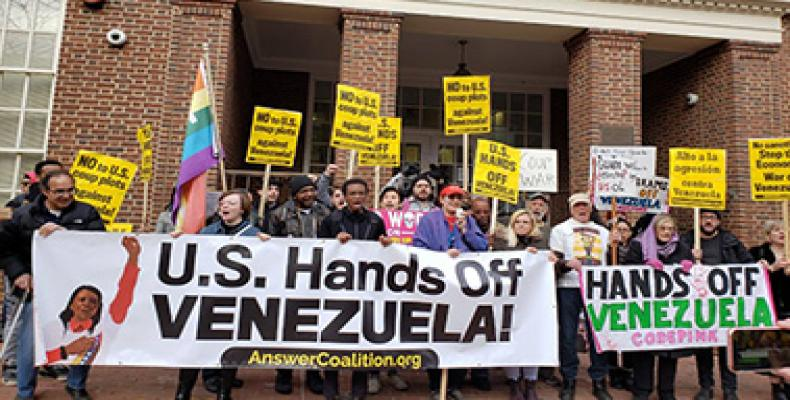 Code Pink members opposse Venezuelan right wing opposition outside Embassy in Washington D.C.