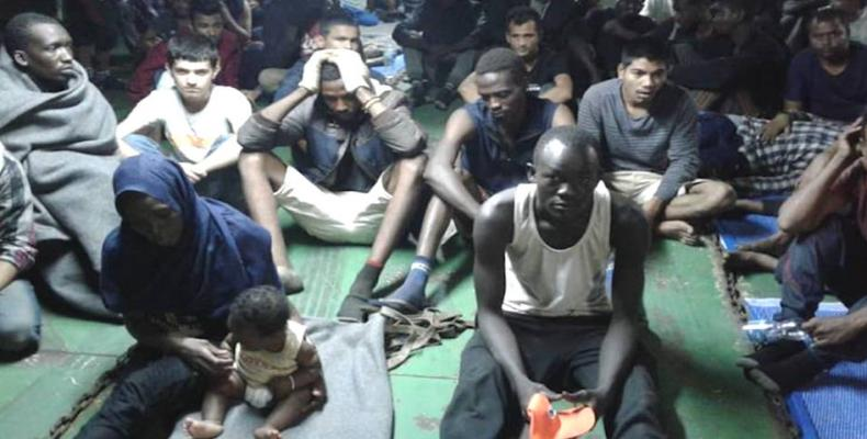 Asylum-seekers refuse to leave docked Libyan ship, citing torture.  Photo: Democracy Now