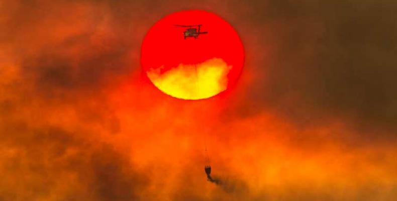 Consideran expertos que cambio climático empeora incendios en California. Foto:PL.