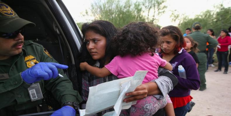 U.S. policy of separating young children from mothers is criminal.  Photo: AFP